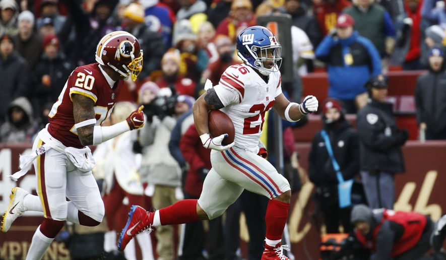 7bfd83509 New York Giants running back Saquon Barkley (26) runs away from Washington  Redskins strong