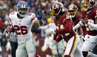 New York Giants running back Saquon Barkley (26) runs as he is pursued by Washington Redskins cornerback Josh Norman (24) and others during the first half of an NFL football game Sunday, Dec. 9, 2018, in Landover, Md. (AP Photo/Patrick Semansky)