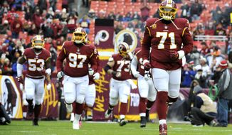 Washington Redskins run onto the field prior to during an NFL football game against the New York Giants, Sunday, Dec. 9, 2018, in Landover, Md. (AP Photo/Mark Tenally) ** FILE **