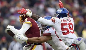 Washington Redskins quarterback Mark Sanchez (6) is sacked by New York Giants outside linebacker Olivier Vernon (54) and linebacker Lorenzo Carter (59) during the first half of an NFL football game Sunday, Dec. 9, 2018, in Landover, Md. (AP Photo/Nick Wass)