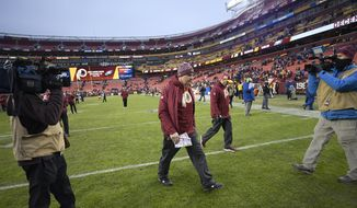 Washington Redskins head coach Jay Gruden walks off the field after an NFL football game against the New York Giants, Sunday, Dec. 9, 2018, in Landover, Md. The Giants won 40-16. (AP Photo/Nick Wass)