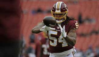 Washington Redskins inside linebacker Mason Foster warms up prior to an NFL football game against the New York Giants, Sunday, Dec. 9, 2018, in Landover, Md. (AP Photo/Mark Tenally)