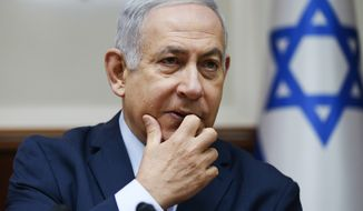 Israeli Prime Minister Benjamin Netanyahu chairs the weekly cabinet meeting at his office in Jerusalem, Sunday, Dec. 9, 2018. (AP Photo/Oded Balilty, Pool)