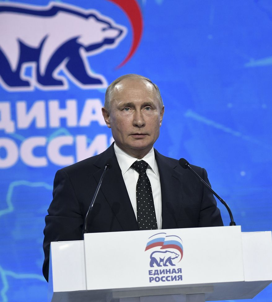 Russian President Vladimir Putin gestures as he delivers his speech at the United Russia party congress in Moscow, Russia, Saturday, Dec. 8, 2018. (Alexei Nikolsky, Sputnik, Kremlin Pool Photo via AP)