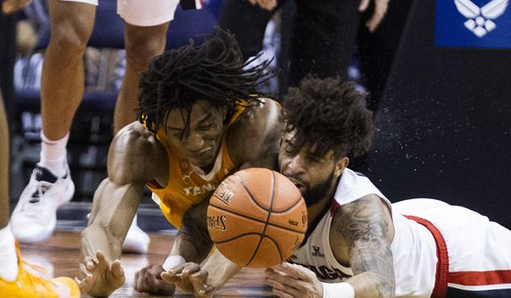 Tennessee's Yves Pons (35) and Gonzaga's Josh Perkins (13) collide while going for the ball during the first half of an NCAA college basketball game Sunday, Dec. 9, 2018, in Phoenix. (AP Photo/Darryl Webb)