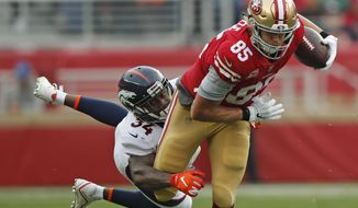 San Francisco 49ers tight end George Kittle (85) runs with the ball away from Denver Broncos strong safety Will Parks (34) during the first half of an NFL football game Sunday, Dec. 9, 2018, in Santa Clara, Calif. (AP Photo/John Hefti)