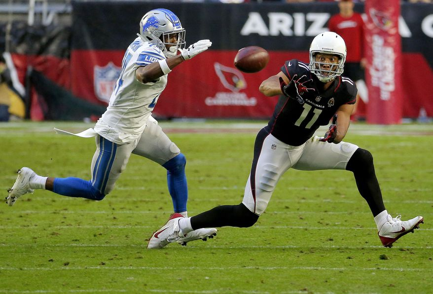 Arizona Cardinals wide receiver Larry Fitzgerald (11) makes his 1,282nd career catch to surpass NFL Hall of Famer Jerry Rice for the most receptions with one team in NFL history during the second half of an NFL football game as Detroit Lions cornerback Nevin Lawson (24) defends, Sunday, Dec. 9, 2018, in Glendale, Ariz. (AP Photo/Rick Scuteri)