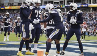 Los Angeles Chargers wide receiver Keenan Allen, center, celebrates his touchdown catch with teammates during the first half of an NFL football game against the Cincinnati Bengals Sunday, Dec. 9, 2018, in Carson, Calif. (AP Photo/Jae C. Hong )