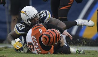 Los Angeles Chargers defensive tackle Darius Philon, top, sacks Cincinnati Bengals quarterback Jeff Driskel (6) on a two-point conversion attempt late in the fourth quarter during an NFL football game Sunday, Dec. 9, 2018, in Carson, Calif. (AP Photo/Mark J. Terrill)