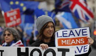 Demonstrators protest for Britain's Brexit split from Europe, outside the Houses of Parliament in London Thursday Dec. 6, 2018.  Britain's Prime Minister Theresa May's effort to win support for her Brexit agreement comes amid reports in British newspapers Thursday, predicting that Parliament could reject the deal by more than 100 votes. (AP Photo/Frank Augstein)