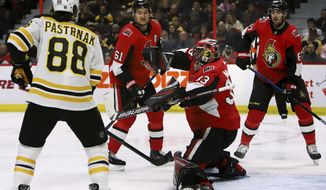 Boston Bruins right wing David Pastrnak (88) looks on as Ottawa Senators goaltender Mike McKenna (33) makes a blocker save during first-period NHL hockey game action in Ottawa, Ontario, Sunday, Dec. 9, 2018. (Fred Chartrand/The Canadian Press via AP)