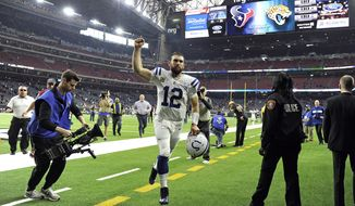 Indianapolis Colts quarterback Andrew Luck (12) celebrates as he leaves the field after an NFL football game against the Houston Texans Sunday, Dec. 9, 2018, in Houston. The Colts won 24-21. (AP Photo/Eric Christian Smith)