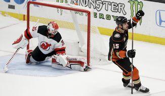 Anaheim Ducks center Ryan Getzlaf celebrates after scoring the game winning goal past New Jersey Devils goaltender Cory Schneider during a shootout in an NHL hockey game in Anaheim, Calif., Sunday, Dec. 9, 2018. (AP Photo/Chris Carlson)