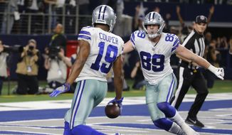 Dallas Cowboys wide receiver Amari Cooper (19) scores on a 15-yard catch against the Philadelphia Eagles in overtime of an NFL football game, in Arlington, Texas, Sunday, Dec. 9, 2018. (AP Photo/Michael Ainsworth)