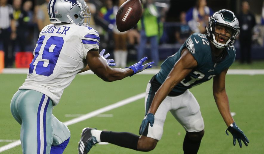 Dallas Cowboys wide receiver Amari Cooper (19) makes a 15-yard catch in front of Philadelphia Eagles cornerback Rasul Douglas (32) for a touchdown in overtime of an NFL football game, in Arlington, Texas, Sunday, Dec. 9, 2018. (AP Photo/Michael Ainsworth)