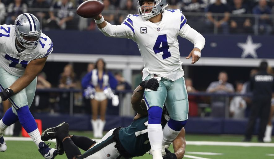 Dallas Cowboys quarterback Dak Prescott (4) is pressured by Philadelphia Eagles defensive end Michael Bennett (77) during the first half of an NFL football game, in Arlington, Texas, Sunday, Dec. 9, 2018. (AP Photo/Tony Gutierrez)