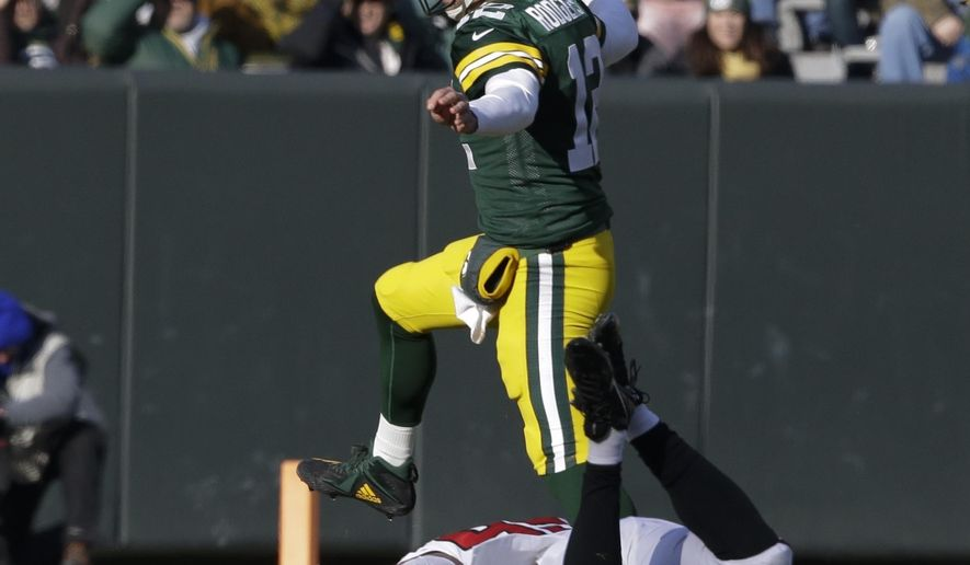 f3fd28069 Green Bay Packers  39  Aaron Rodgers scrambles during the first half of an  NFL