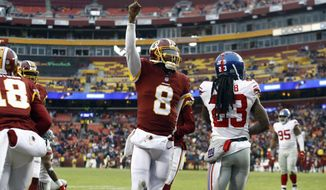Washington Redskins quarterback Josh Johnson (8) celebrates his touchdown during the second half of an NFL football game against the New York Giants, Sunday, Dec. 9, 2018, in Landover, Md. (AP Photo/Patrick Semansky)