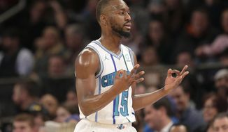 Charlotte Hornets' Kemba Walker reacts after hitting a three-point basket during the second half of the NBA basketball game against the New York Knicks, Sunday, Dec. 9, 2018, in New York. The Hornets defeated the Knicks 119-107. (AP Photo/Seth Wenig)