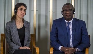 Nobel peace price laureates Nadia Murad, left, and Dr. Denis Mukwege look on during the press conference at the Nobelinstituttet in Oslo, Sunday Dec. 9, 2018. (Heiko Junge/NTB scanpix via AP)