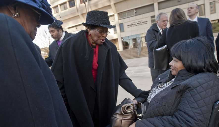 FILE - In this Dec. 12, 2013, file photo, Mary Perry, of Wendell, from left, Rosanell Eaton, of Franklin County, and Carolyn Coleman, of Greensboro, talk after a hearing at the Ward Federal Building in Winston-Salem, N.C., challenging the new North Carolina voting law. African-American North Carolina voting rights activist Eaton has died at age 97. Eaton's daughter, Armenta Eaton, says her mother died Saturday, Dec. 8, 2018, at home in Louisburg, North Carolina (Walt Unks/The Winston-Salem Journal via AP)