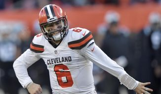 Cleveland Browns quarterback Baker Mayfield celebrates after running back Nick Chubb rushed for a 4-yard touchdown during the second half of an NFL football game against the Carolina Panthers, Sunday, Dec. 9, 2018, in Cleveland. (AP Photo/David Richard)