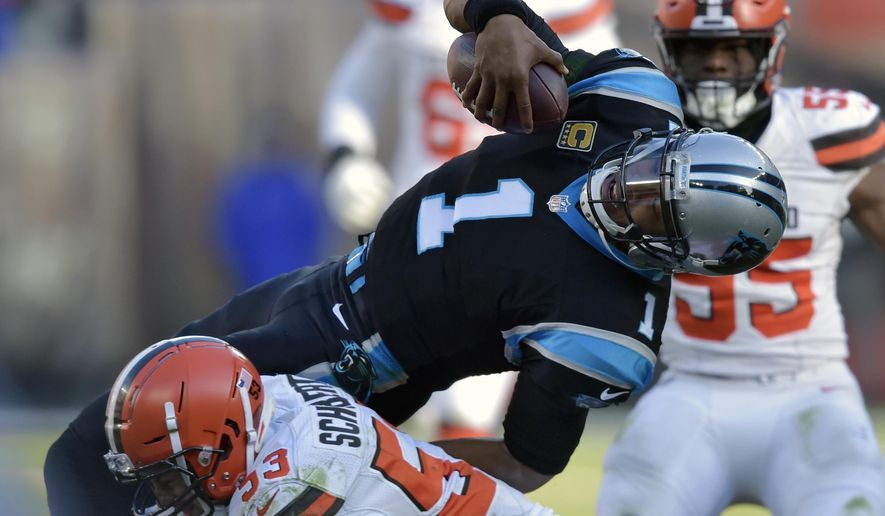 Carolina Panthers quarterback Cam Newton (1) is tackled by Cleveland Browns linebacker Joe Schobert (53) after rushing during the second half of an NFL football game, Sunday, Dec. 9, 2018, in Cleveland. (AP Photo/David Richard)