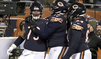 Chicago Bears offensive tackle Bradley Sowell (79) celebrates a touchdown reception with teammates during the second half of an NFL football game against the Los Angeles Rams Sunday, Dec. 9, 2018, in Chicago. (AP Photo/Nam Y. Huh)
