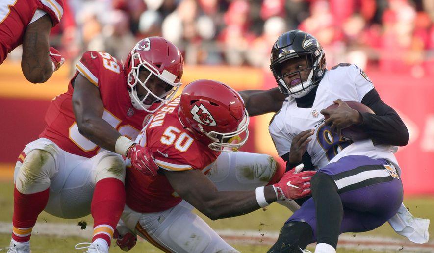 Kansas City Chiefs linebackers Justin Houston (50) and Reggie Ragland (59) sack Baltimore Ravens quarterback Lamar Jackson (8) during the second half of an NFL football game in Kansas City, Mo., Sunday, Dec. 9, 2018. (AP Photo/Ed Zurga)