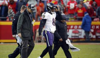 Baltimore Ravens quarterback Lamar Jackson (8) is helped off the field after an injury in overtime of an NFL football game against the Kansas City Chiefs in Kansas City, Mo., Sunday, Dec. 9, 2018. (AP Photo/Charlie Riedel) **FILE**