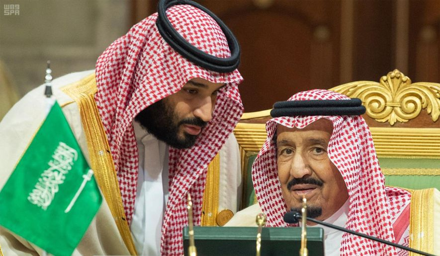 In this photo released by the state-run Saudi Press Agency, Saudi Crown Prince Mohammed bin Salman, left, speaks to his father, King Salman, right, at a meeting of the Gulf Cooperation Council in Riyadh, Saudi Arabia, Sunday, Dec. 9, 2018. Leaders of Gulf Arab countries, including those boycotting Qatar, met on Sunday in Saudi Arabia's capital for a regional summit, a gathering that Qatar's ruling emir choose not to attend amid the dispute. (Saudi Press Agency via AP) ** FILE **