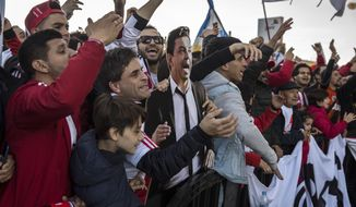 "River Plate supporters hold a cutout of River Plate's coach Marcelo Gallardo ahead of the Copa Libertadores Final between River Plate and Boca Juniors in Madrid, Sunday, Dec. 9, 2018. Tens of thousands of Boca and River fans are in the city for the ""superclasico"" at Santiago Bernabeu Stadium on Sunday. (AP Photo/Olmo Calvo)"