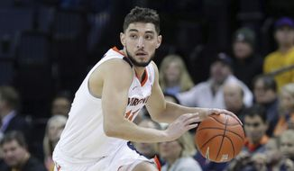 Virginia guard Ty Jerome (11) drives downcourt during an NCAA college basketball game against Virginia Commonwealth, Sunday, Dec. 9, 2018, in Charlottesville, Va. (AP Photo/Andrew Shurtleff)