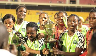 Nigeria Women female soccer team players celebrates with the trophy after winning against Bayana Bayana of South Africa, at the end of the women Africa Cup of Nations finals in Accra, Ghana, Saturday Dec. 1, 2018. Nigeria won its 11th title in 13 editions of the Women's African Cup of Nations by beating South Africa in a penalty shootout in the final on Saturday. The game ended 0-0 after 120 minutes and although Nigeria missed its first penalty kick in the shootout, when Onome Ebi hit the post, South Africa missed twice and the Nigerians prevailed 4-3. (AP Photo/Alade Omowunmi )