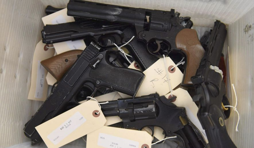 This June 2, 2018, file photo provided by the Chicago Police Department shows weapons turned in by residents in a gun buy-back program co-sponsored with the New Life Covenant Church Southeast in the 6th Police District. More than 400 guns and rifles were handed over in exchange for $100 gift cards. (CPD via AP) ** FILE **
