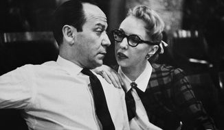 """Broadway composer Frank Loesser and his wife and musical partner Lynn are shown, April 26, 1956 in New York.  Their song """"Baby, It's Cold Outside"""" was originally a song they performed for friends at their housewarming party. (AP Photo/Anthony Camerano)"""