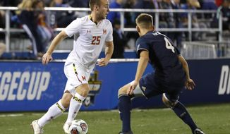 University of Maryland's Ben Di Rosa tries to make a move around Akron's Marco Milanes during the 2018 NCAA College Cup soccer match at the University California in Santa Barbara, Calif., Sunday, Dec. 9, 2018. University of Maryland defeated Akron 1-0 to win the championship. (AP Photo/Daniel Dreifuss) ** FILE **