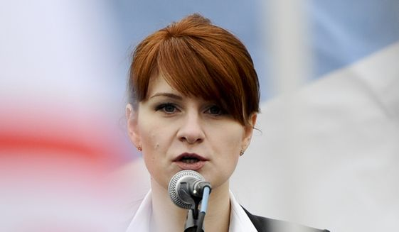 """In this April 21, 2013, file photo, Maria Butina, leader of a pro-gun organization in Russia, speaks to a crowd during a rally in support of legalizing the possession of handguns in Moscow, Russia. Prosecutors say they have """"resolved"""" a case against Butina accused of being a secret agent for the Russian government, a sign that she likely has taken a plea deal. The information was included in a court filing Monday. (AP Photo/File)"""