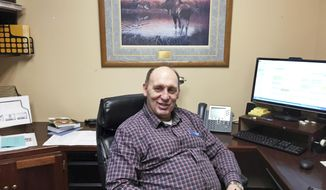 "FILE - In this Jan. 16, 2017, file photo, then Rep.-elect Gary Knopp sits in his office at the Alaska Capitol in Juneau, Alaska. Republican state lawmaker Knopp is seeking to create a bipartisan majority coalition in the House after leaving a fragile GOP caucus that he said was ""doomed to fail."" Knopp says he wanted to start talks on the potential creation of a bipartisan coalition, with just weeks before the start of the new legislative session. (AP Photo/Becky Bohrer, File)"