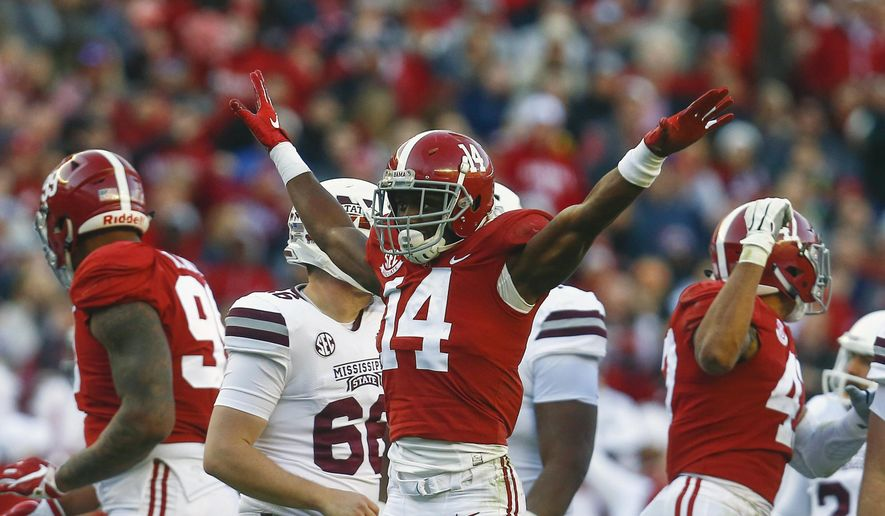 FILE - In this Nov. 10, 2018, file photo, Alabama defensive back Deionte Thompson (14) celebrates after Mississippi State place kicker Jace Christmann (47) missed a field goal-attempt during the first half of a game, in Tuscaloosa, Ala. Thompson was named to the 2018 AP All-America NCAA college football team, Monday, Dec. 10, 2018. (AP Photo/Butch Dill, File)