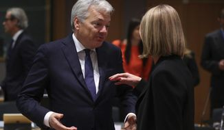 Belgium's Foreign Minister Didier Reynders, left, talks to European Union Foreign Policy chief Federica Mogherini prior a meeting of EU Foreign Affairs ministers at the European Council headquarters in Brussels, Monday, Dec. 10, 2018. (AP Photo/Francisco Seco)