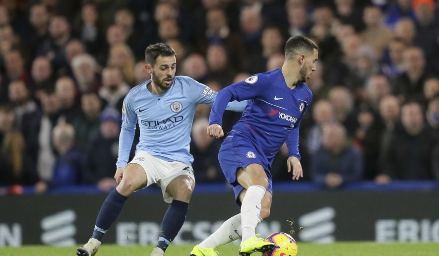 Chelsea's Eden Hazard, right, and Manchester City's Bernardo Silva fight for the ball during the English Premier League soccer match between Chelsea and Manchester City at Stamford Bridge in London, Saturday Dec. 8, 2018. (AP Photo/Tim Ireland)