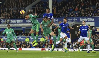 Watford's Jose Holebas heads the ball during the English Premier League soccer match against Everton at Goodison Park, Liverpool, England, Monday Dec. 10, 2018. (Peter Byrne/PA via AP)
