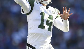 New York Jets quarterback Sam Darnold passes against the Buffalo Bills during the first half of an NFL football game, Sunday, Dec. 9, 2018, in Orchard Park, N.Y. (AP Photo/Adrian Kraus)