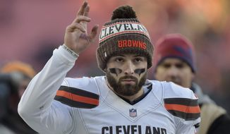 Cleveland Browns quarterback Baker Mayfield walks off the field after the Browns defeated the Carolina Panthers in an NFL football game, Sunday, Dec. 9, 2018, in Cleveland. (AP Photo/David Richard)