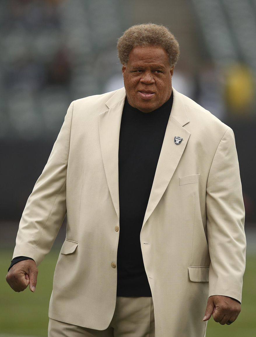 FILE - In this Dec. 9, 2018, file photo, Oakland Raiders general manager Reggie McKenzie stands on the field before an NFL football game between the Raiders and the Pittsburgh Steelers in Oakland, Calif. The Oakland Raiders have fired general manager Reggie McKenzie less than two years after he was named the NFL's executive of the year. A person familiar with the move says McKenzie was let go on Monday, Dec. 10, 2018, from the position he had held for almost seven seasons. The person spoke on condition of anonymity because the team has not made an announcement. (AP Photo/Ben Margot, File)