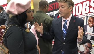 Sen. Rand Paul speaks with people at the Louisville Urban League on Monday, Dec. 10, 2018, after making another push for a federal criminal justice bill, in Louisville, Ky. Paul urged Kentuckians to contact Senate Majority Leader Mitch McConnell to urge a Senate vote on the measure. (AP Photo/Bruce Schreiner)