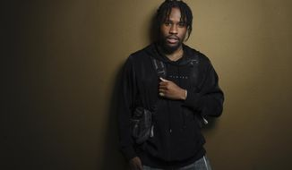 """In this Nov. 30, 2018 photo, Shameik Moore, a cast member in """"Spider-man: Into the Spider-Verse,"""" poses for a portrait at the Four Seasons Hotel in Los Angeles. (Photo by Chris Pizzello/Invision/AP)"""