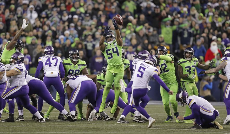Seattle Seahawks' Bobby Wagner (54) leaps to block a field goal attempt by Minnesota Vikings' Dan Bailey in the second half of an NFL football game, Monday, Dec. 10, 2018, in Seattle. (AP Photo/Stephen Brashear)