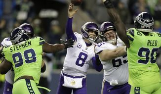 Minnesota Vikings quarterback Kirk Cousins (8) passes against the Seattle Seahawks in the first half of an NFL football game, Monday, Dec. 10, 2018, in Seattle. (AP Photo/Stephen Brashear)